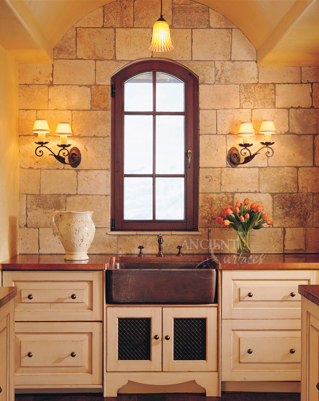 Antique Limestone on a kitchen backs plash by Ancient Surfaces.