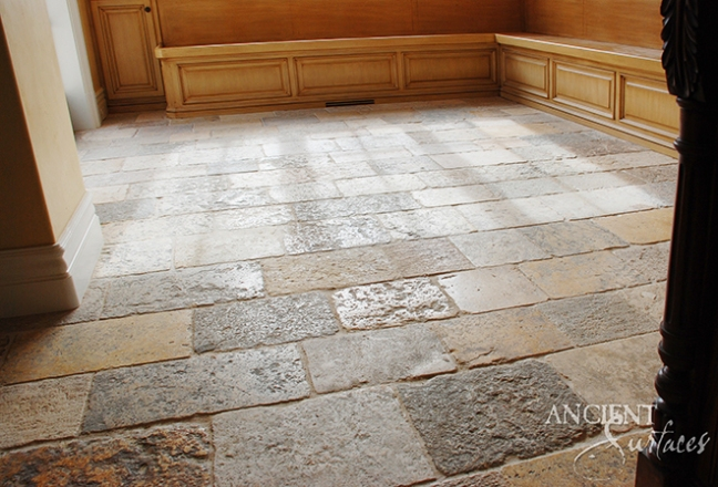 Antique Limestoe floors in a librabry study room by Ancient Surfaces.