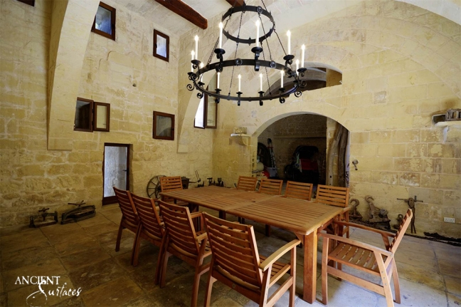 beautiful-limestone-floors-with-antique-wall-cladding-in-old-provencal-dining-room