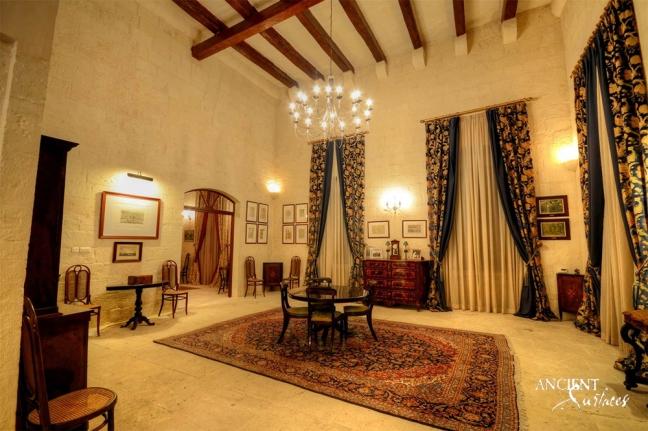 mediterrenean-look-living-room-with-limestone-flooring-and-limestone-wall-cladding