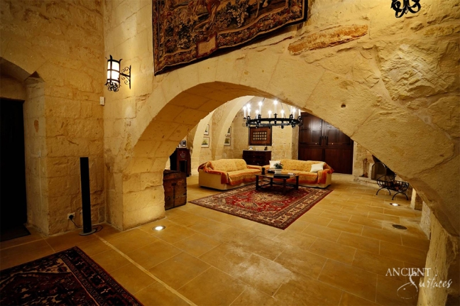 old-world-style-living-room-with-limestone-flooring